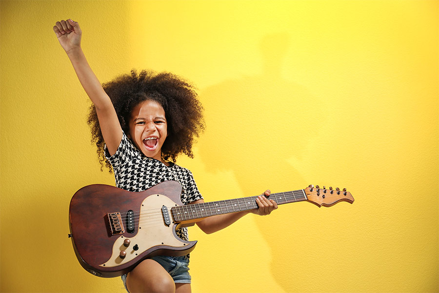 Young Fun Model Girl Playing Guitar