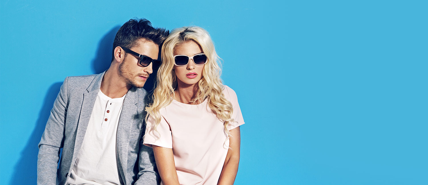 Attractive Couple Sitting Wearing Sunglasses